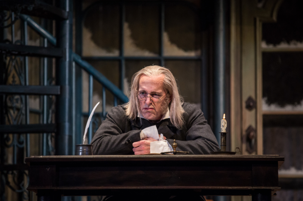 Larry Yando as Ebenezer Scrooge in A Christmas Carol, directed by Henry Wishcamper, at the Goodman Theatre.
