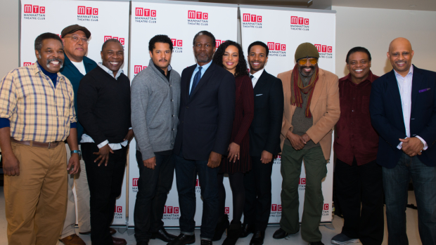 The full cast of Jitney poses with their director  Ruben Santiago-Hudson.