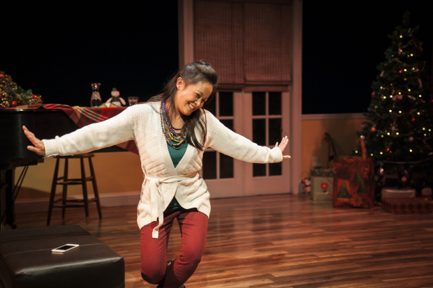 Christine Bunuan in her solo show Christmas at Christine's, directed by J.R. Sullivan, at Silk Road Rising.