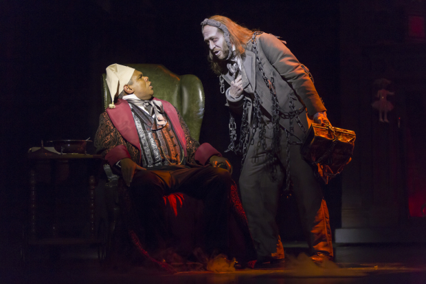 Craig Wallace as Ebenezer Scrooge and James Konicek as Jacob Marley in A Christmas Carol, directed by Michael Baron, at Ford's Theatre.