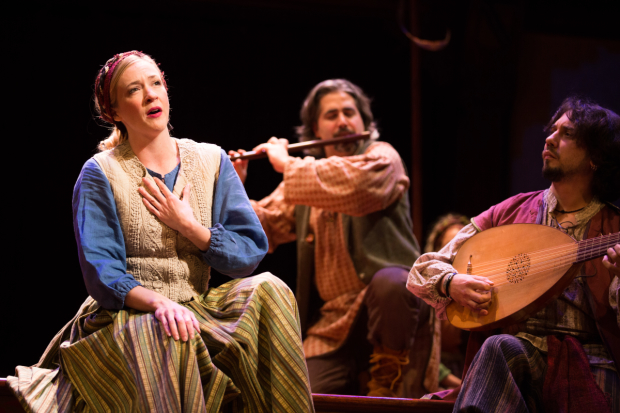 Emily Noël sings a festive tune played by musicians Daniel Meyers and Brian Kay in The Second Shepherds' Play, directed by Mary Hall Surface, at Folger Shakespeare Theatre.