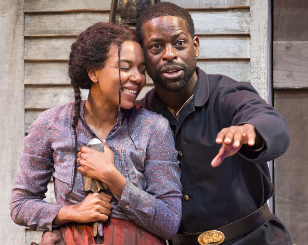 Sameerah Luqmaan-Harris and Sterling K. Brown in Father Comes Home From the Wars (Parts 1, 2 & 3), directed by Jo Bonney, at Center Theatre Group/Mark Taper Forum.