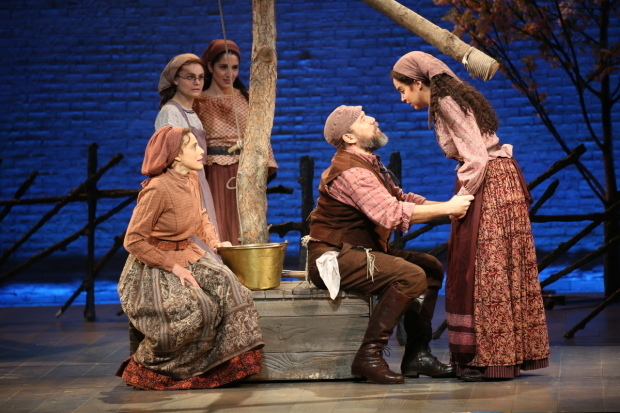 Judy Kuhn and Danny Burstein as Golde and Tevye with onstage daughters Melanie Moore, Samantha Massell, and Alexandra Silber.