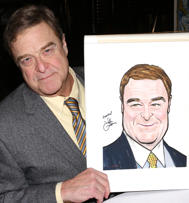 John Goodman poses with his caricature.