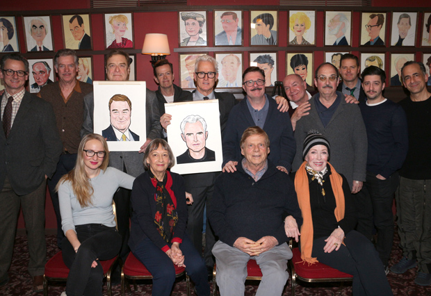 The cast of The Front Page helps John Goodman and John Slattery toast their Sardi's caricatures.