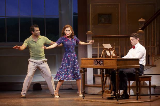 Corbin Bleu, Lora Lee Gayer, and Bryce Pinkham perform around the piano in  Holiday Inn.