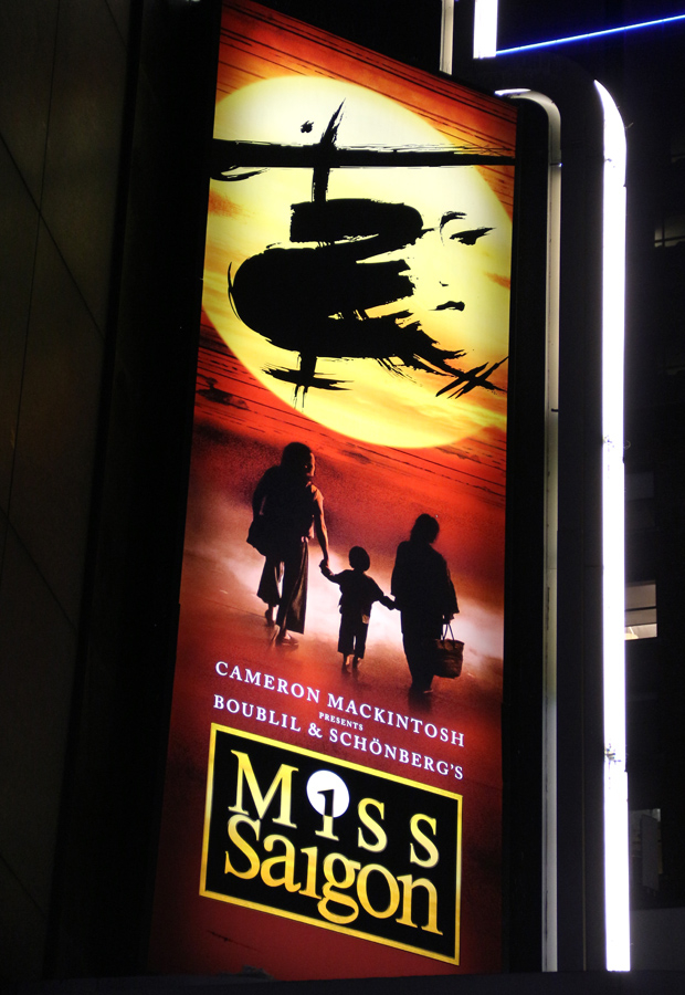 The Miss Saigon marquee is lit up at the Broadway Theatre.