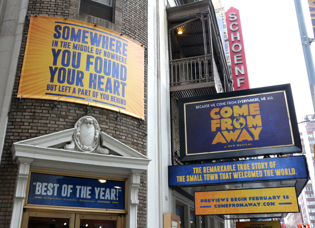 The Come From Away front of house artwork at the Schoenfeld Theatre.