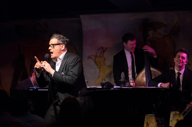 Isaac Mizrahi (foreground) sings his Café Carlyle debut backed by Ben Waltzer, Neal Miner, and Benny Benack III.