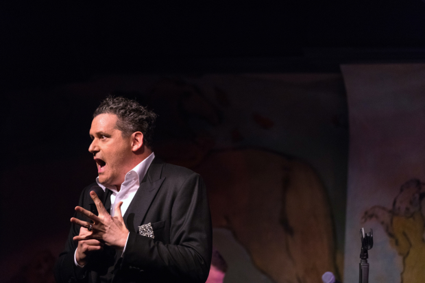 Isaac Mizrahi regales the audience at Café Carlyle with one of his dishy anecdotes.