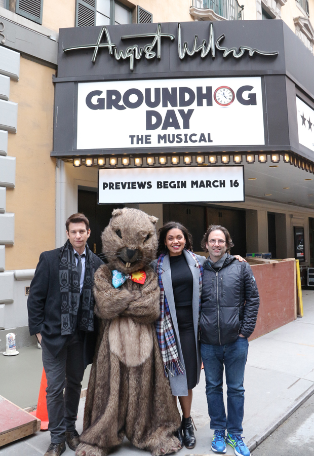 Andy Karl, Mr. Groundhog, Barrett Doss, and Danny Rubin poses under the August Wilson Theatre marquee.