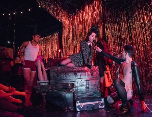 Natalie Walker (center) as Sally Bowles in the Secret Theater's production of Cabaret.