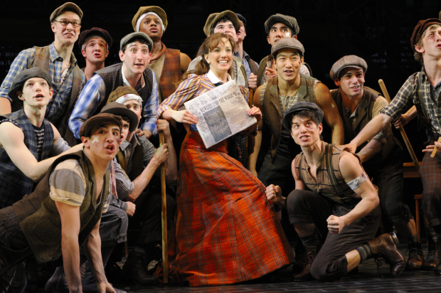 "Kara Lindsay (center) leads the production number ""King of New York"" in the 2012 Broadway production of Newsies."