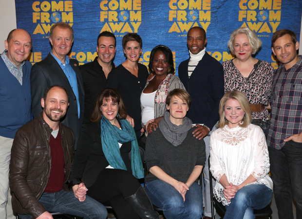 The cast members of Come From Away poses for a photo in their rehearsal room.