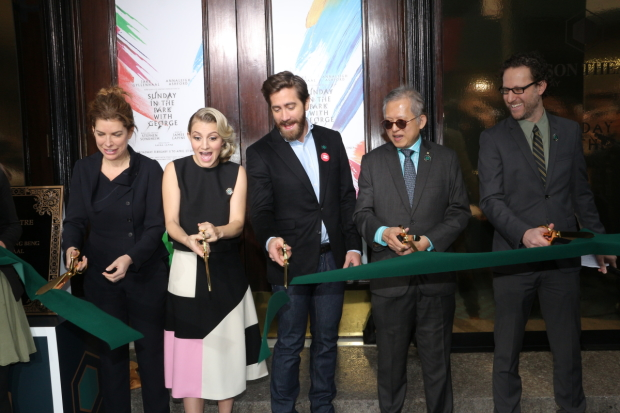 Annaleigh Ashford and Jake Gyllenhaal (center) cut the ribbon on the newly reopened Hudson Theatre.