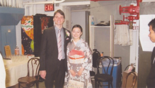 Dan Urness and Minami Yusui celebrate their wedding in the basement of the Broadway Theatre.