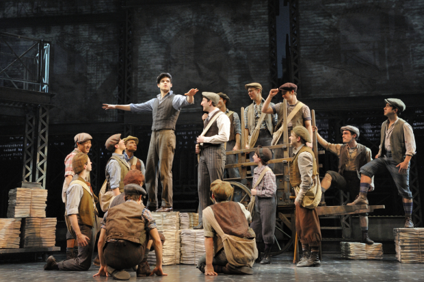 Jeremy Jordan and Ben Fankhauser (center) in a scene from Newsies.