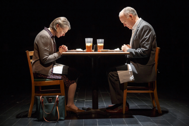 Nancy (Annette O'Toole) and Ken (Reed Birney) pray over cafeteria food in Man From Nebraska.