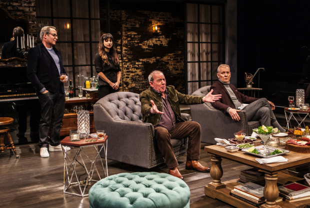 Bill (Michael Tucker, center) expresses an opinion about the government as Robert (Matthew Broderick), Jane (Annapurna Sriram), and Ted (John Epperson) listen warily in Evening at the Talk House.