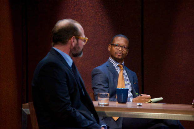 An attorney (Lawrence Gilliard Jr., right) interrogates Charles (Chris Bauer) about his belief in the Bible in The Penitent.