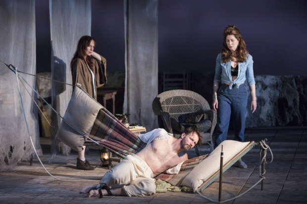 Amanda Plummer (Hannah Jelkes), Bill Heck (Reverend T. Lawrence Shannon), and Dana Delany (Maxine Faulk) in The Night of the Iguana, directed by Michael Wilson, at the American Repertory Theater.