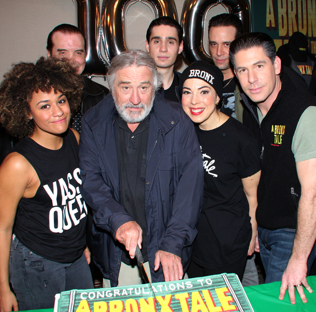 Robert De Niro cuts the Bronx Tale cake with the show's stars by his side.