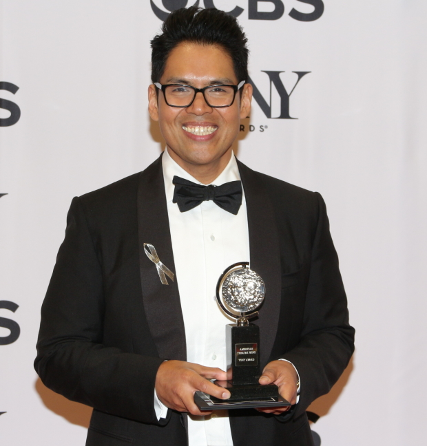 Clint Ramos with his 2016 Tony Award for the costumes of Eclipsed.