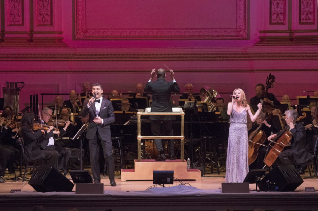 Steven Reineke (center) leads the New York Pops with special guests Tony Yazbeck (left) and Cassie Levy (right).