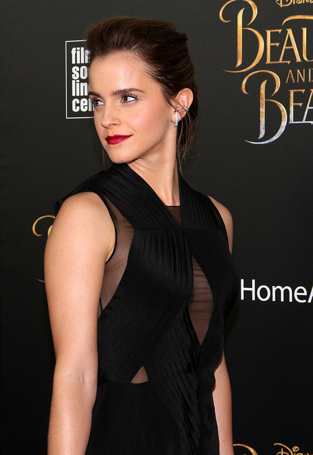 Emma Watson walks the red carpet at the New York premiere of Beauty and the Beast.