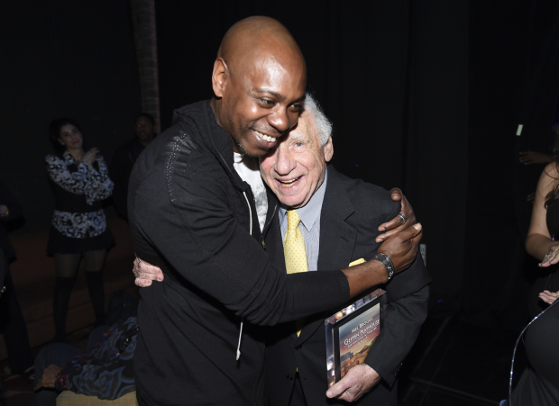 Honoree Mel Brooks gets a hug from Dave Chappelle.