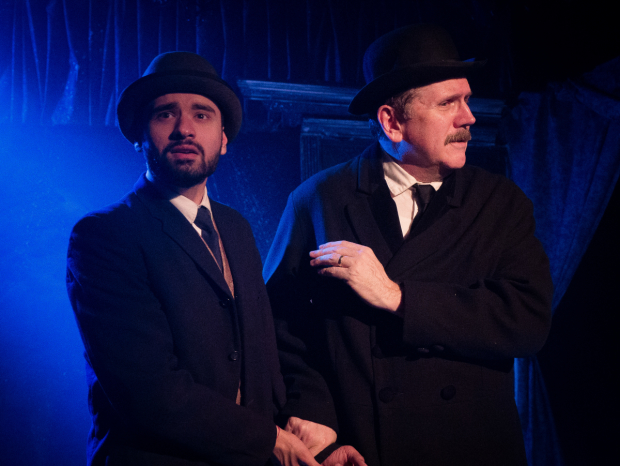 Priyank Thakkar and Robert Koon in a scene from WildClaw Theatre's production of The Woman in Black at the Den Theatre
