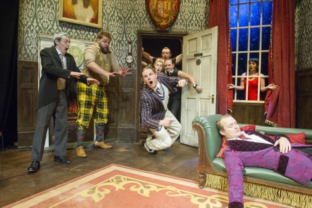 Jonathan Sayer, Henry Lewis, Dave Hearn (center falling), Greg Tannahill (on couch), and Charlie Russell (in window) star in Mischief Theatre's The Play That Goes Wrong, directed by Mark Bell, at Broadway's Lyceum Theatre.
