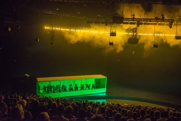 Stewart Laing's set for The Hairy Ape rotates around the audience at the Park Avenue Armory on a conveyor belt.