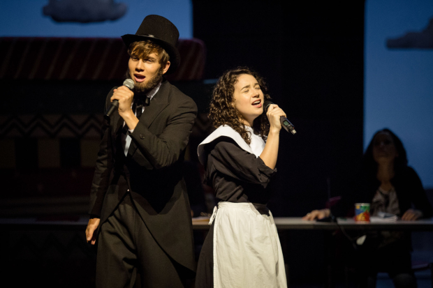 Howie (Austin P. McKenzie) and Diwata (Sarah Steele) perform a musical about Abraham Lincoln and Mary Warren in Speech & Debate.