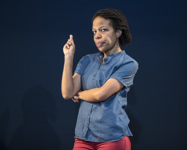 Nilaja Sun in her solo show Pike St., directed by Ron Russell, at Woolly Mammoth Theatre.