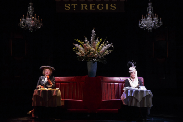 Elizabeth Arden (Christine Ebersole) and Helena Rubinstein (Patti LuPone) sit at separate tables at the St. Regis Hotel in War Paint.