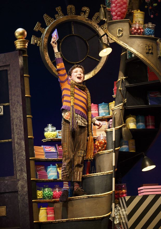 Ryan Sell is excited over his candy bar in a scene from Charlie and the Chocolate Factory.