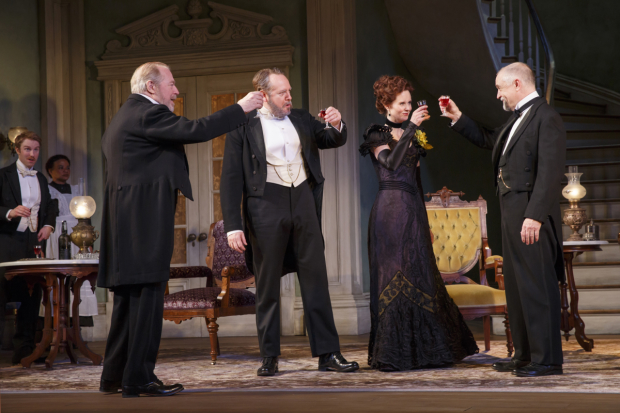 Ben (Michael McKean), Oscar (Darren Goldstein), and Regina (Cynthia Nixon) toast Mr. Marshall (David Alford) in the Broadway revival of The Little Foxes.