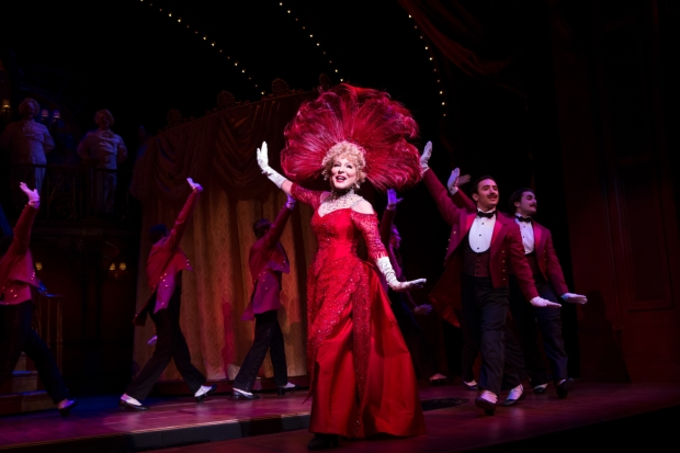 Bette Midler (center) leads the Broadway revival of Hello, Dolly!, directed by Jerry Zaks, at the Shubert Theatre.
