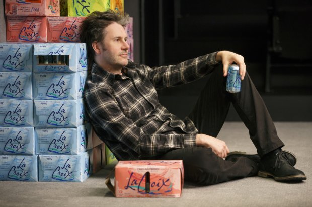 Josh Hamilton helps himself to some seltzer in a scene from The Antipodes.