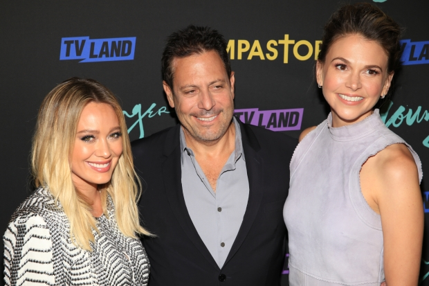 Younger creator Darren Star (center) with the show's stars Hilary Duff and Sutton Foster.