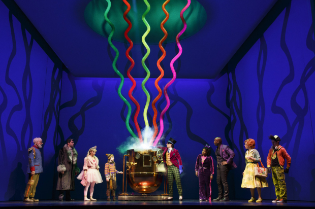 Willy Wonka (Christian Borle, center) demonstrates one of his inventions in Charlie and the Chocolate Factory.