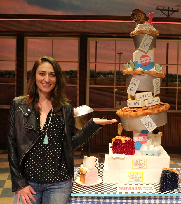 Sara Bareilles poses with the Waitress first anniversary cake.