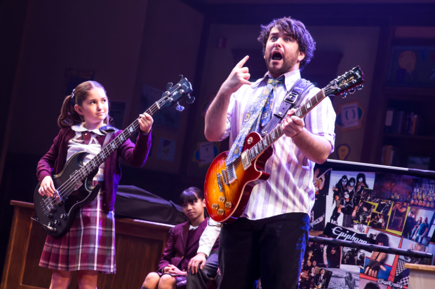 Evie Dolan and Alex Brightman rock out in School of Rock on Broadway.