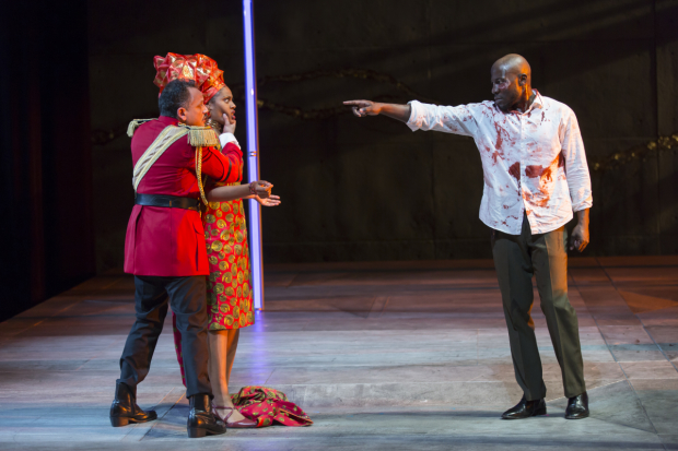 Jesse J. Perez as Macbeth, Nikkole Salter as Lady Macbeth, and McKinley Belcher III as Banquo in Macbeth, directed by Liesl Tommy, at Shakespeare Theatre Company.