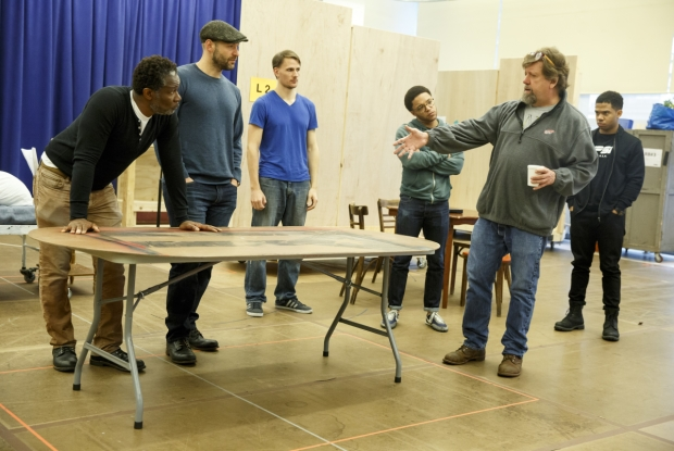 Oskar Eustis (second from right) directs company members in a rehearsal for Julius Caesar, beginning performances June 12 at the Delacorte Theater.