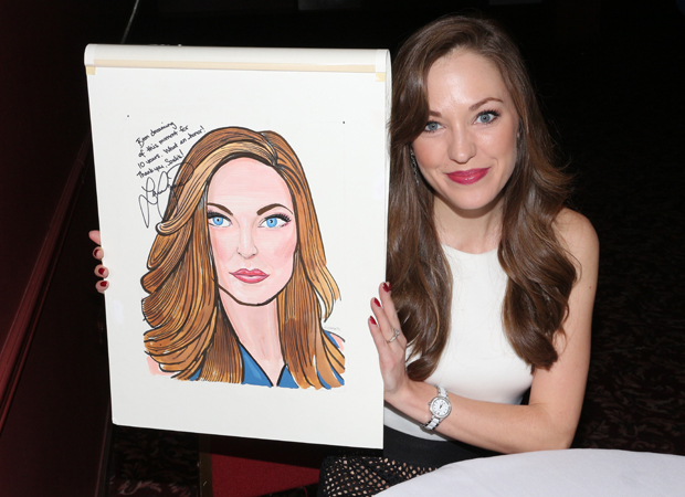 Laura Osnes poses with her Sardi's caricature.