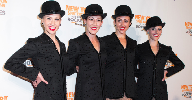 A few Radio City Rockettes pose for a photo.