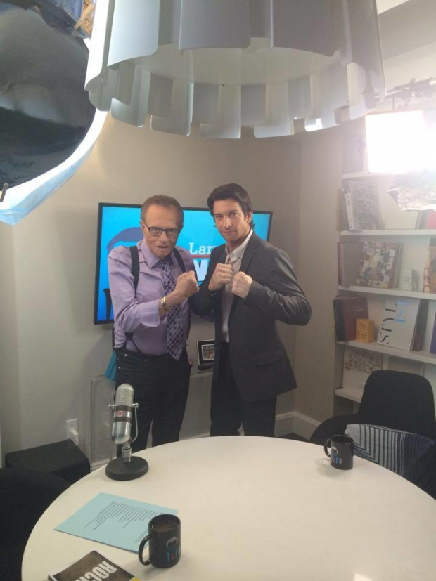 Larry King and Andy Karl give the camera their best Rocky poses.