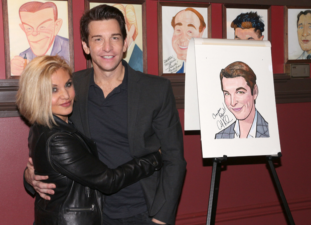 Orfeh and Andy Karl pose with his portrait.
